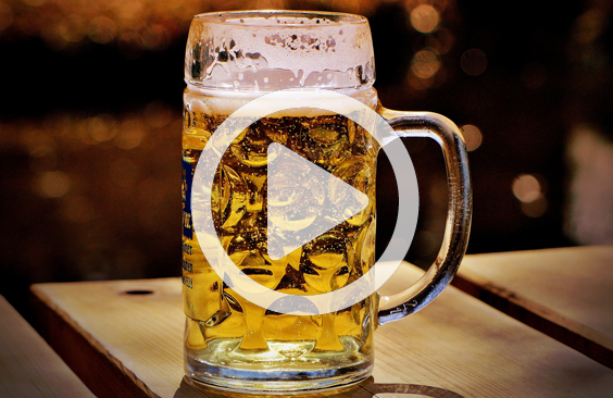 Full beer mug with play button icon